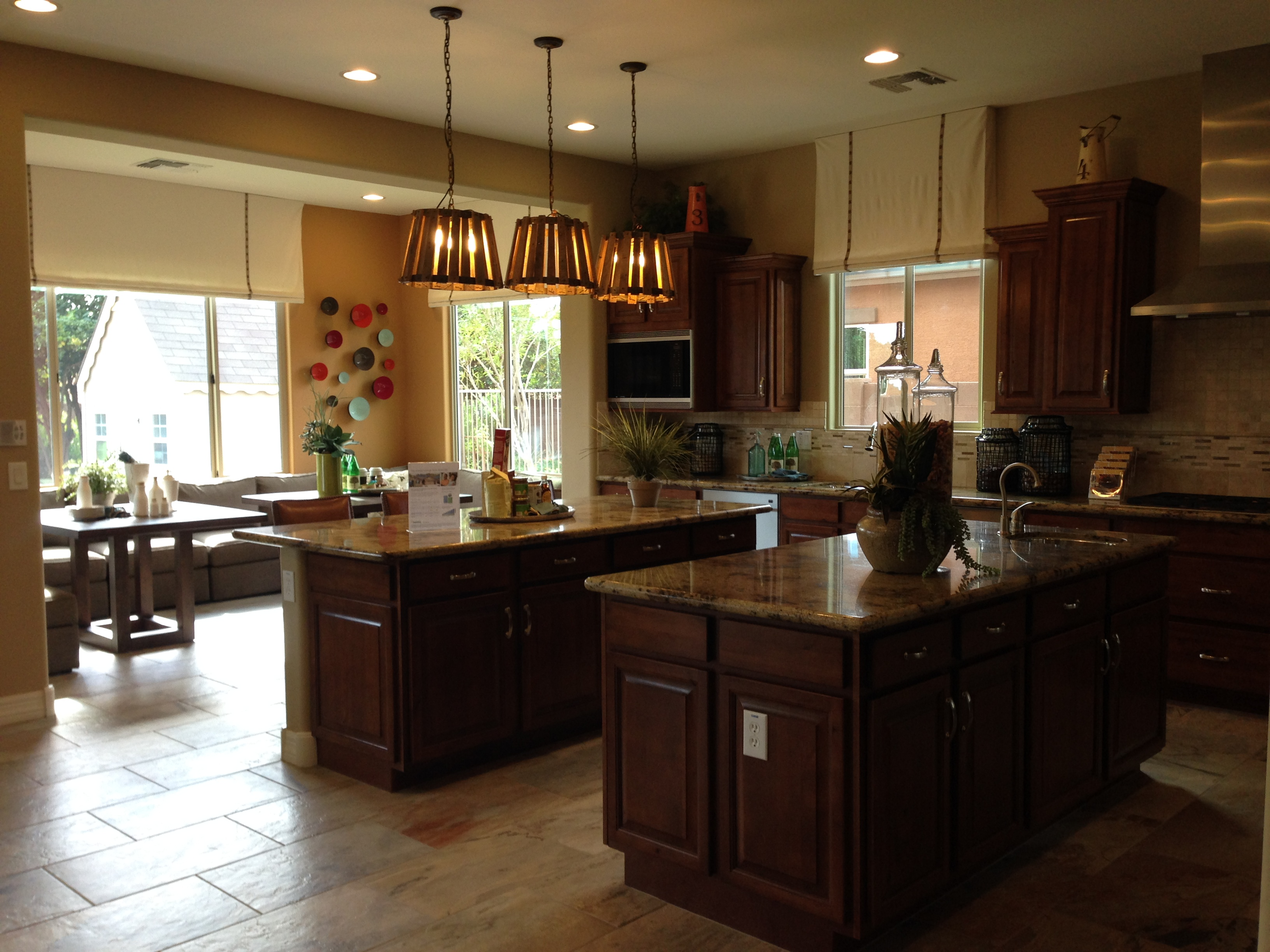 Exceptionnel Model Home Kitchen With Double Islands And Informal Eating Area