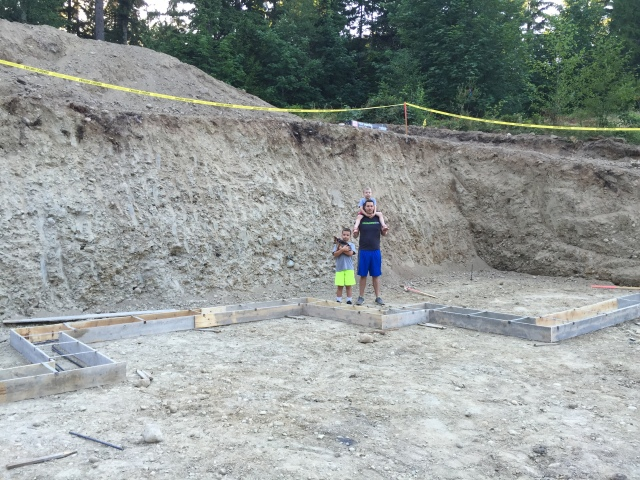 Here's a shot of Joel and the boys standing next to the excavation for the basement - just to give you some scale.