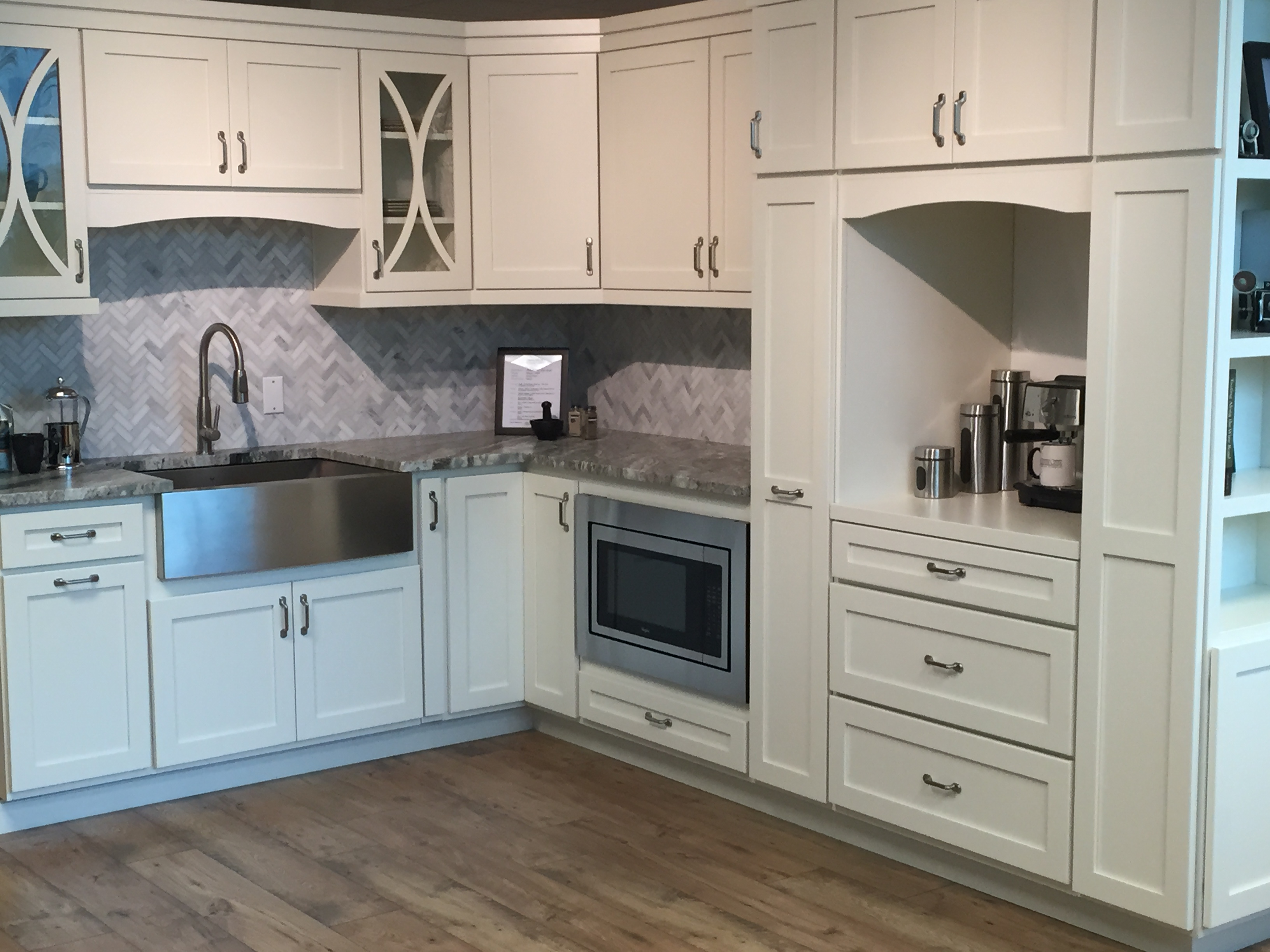 heres a pretty kitchen in their show room with full overlay shaker cabinets