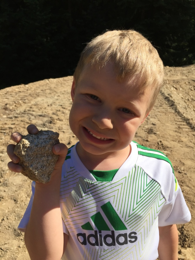 Spencer found his special 'gem' rock.  He said he put it in a safe place to find it later (in the dirt).  Good luck Spencer! ;)