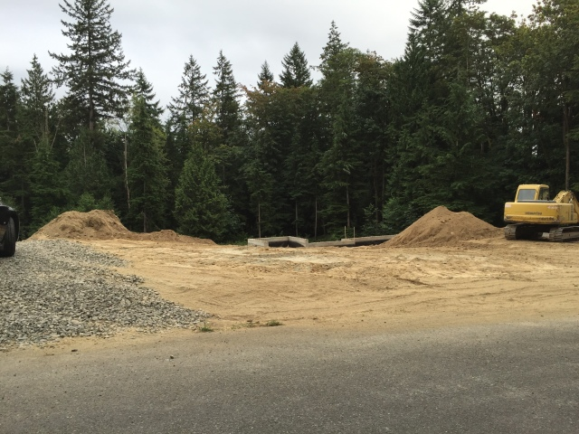 The giant stockpiles of dirt were removed from our future front lawn - you can actually see the basement walls peeking out if you're looking from the road now!