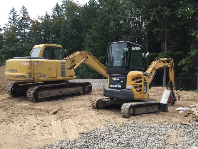 New equipment showed up at the house to regrade and backfill around the house.