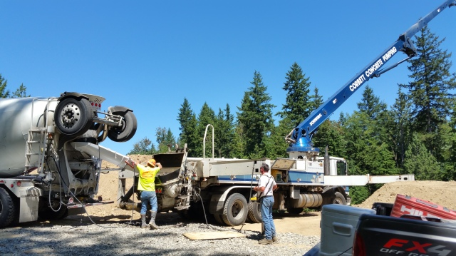 On Wednesday they poured the footings.  From the concrete truck to the pump to our footings.