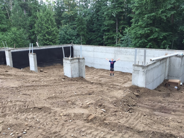 Here's Cameron, standing in the garage with it backfilled part of the way - he'll never get to do that again!