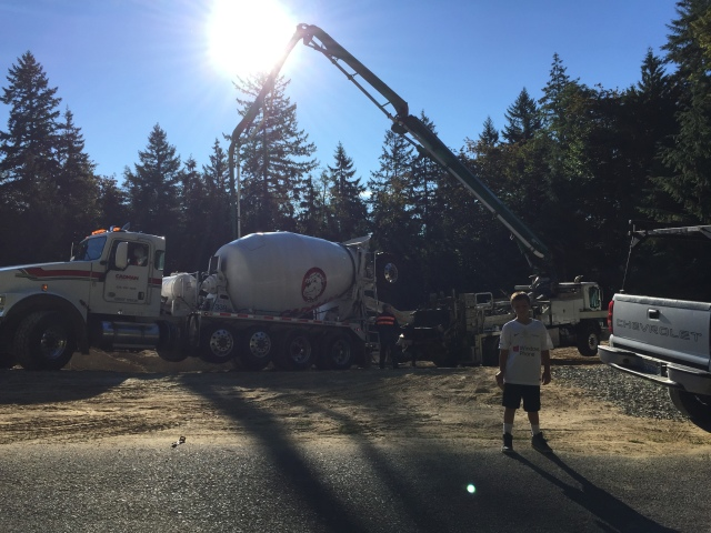 The concrete and pump trucks were situated up by the road with the arm of the pump truck reaching over the basement wall.