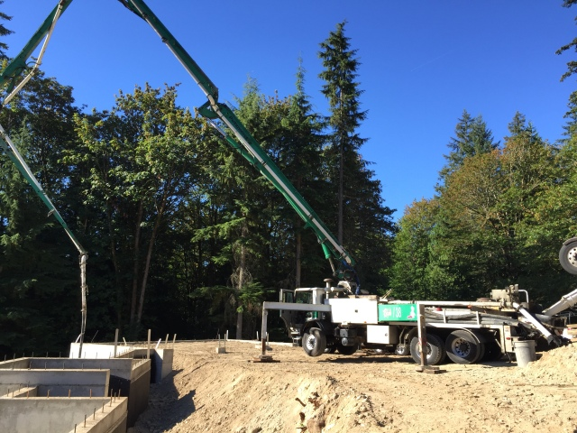 Here's the pump truck - you can really see how uneven and sloped our future driveway is right now!