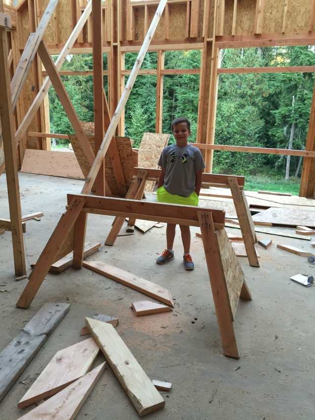 Cameron checked out the house with us this time, and liked the sawhorses!