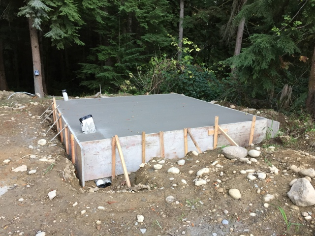 Up close pic of the well house foundation slab.