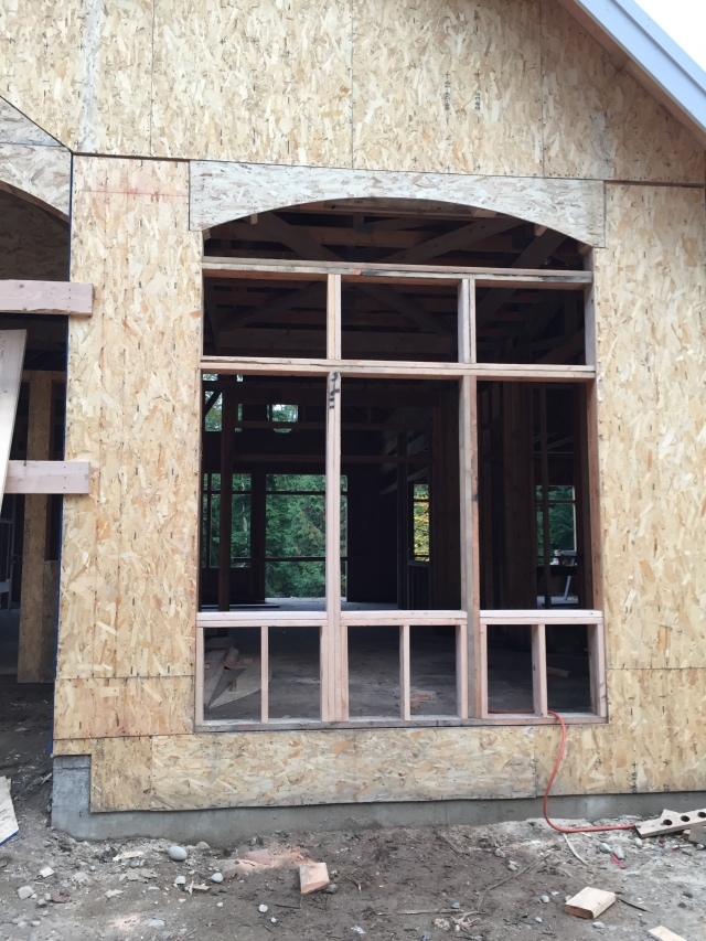 The dining window was framed this week - It'll have three windows that open, then transoms, then an arched window.