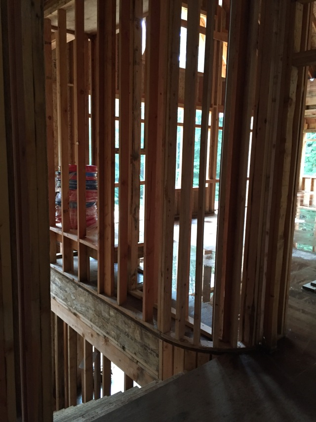 The staircase is located back behind the fireplace, and the curvature in the staircase was finished up this week.