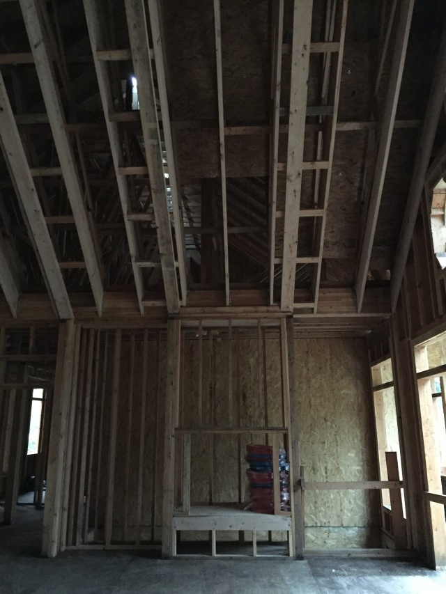 On the left side of the room, the 'beams' align with the fireplace and built-ins.