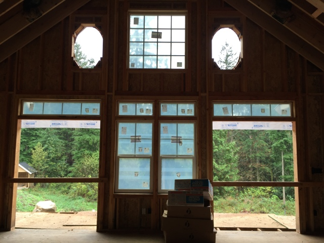 Although we're still missing the french doors and the oval windows, the back wall of the great room is starting to take shape.