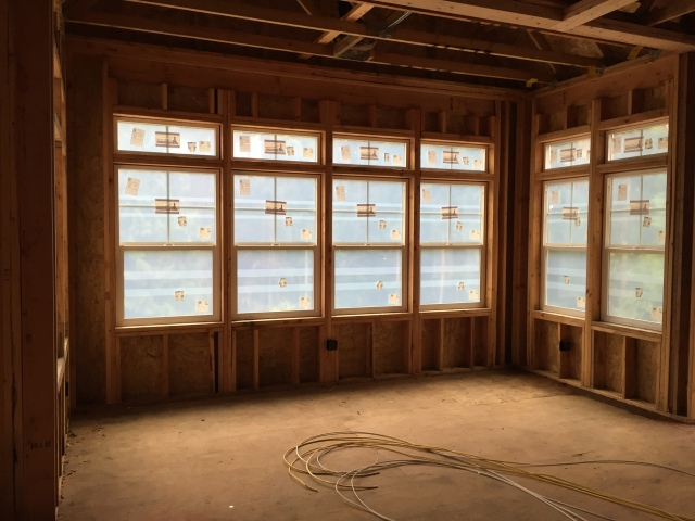 The windows in the informal dining area in the kitchen look amazing! It's too bad that the construction film makes it so we can't see outside anymore. At least that'll protect the glass until construction is finished though.