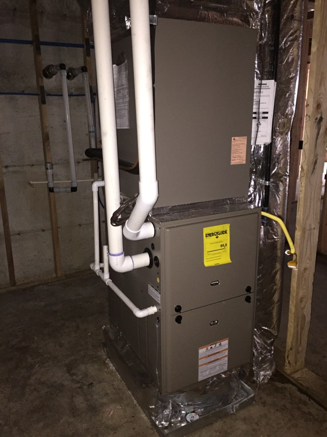 The downstairs furnace is located in the HVAC room.