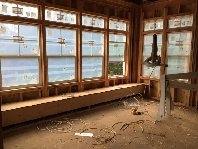 In the kitchen, the banquette bench was installed this week along the back wall of windows.