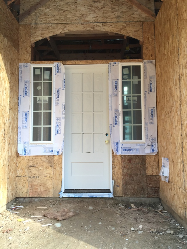 The front door was installed and it looks great! It'll be fun to see it finished once that last window above the door is installed.