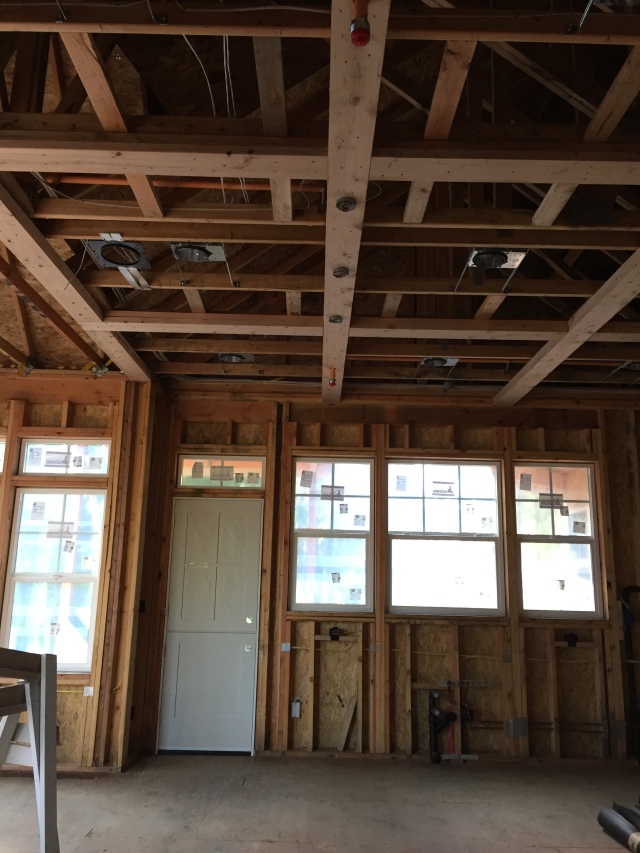 We ended up having to put a couple of the fire sprinklers right on the beams of the coffered ceiling in the kitchen - despite my liking.
