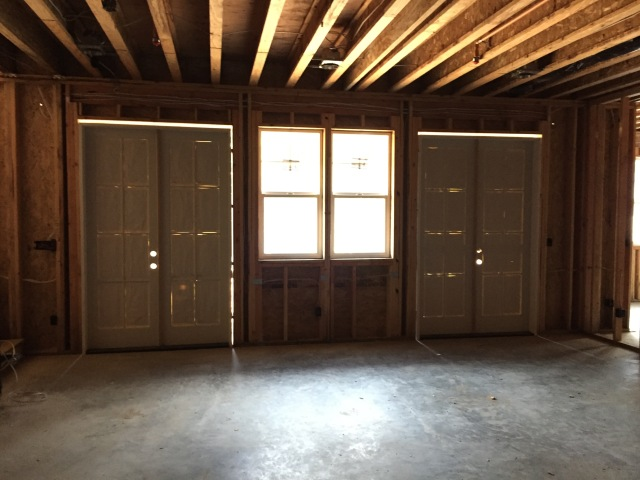 "We skipped the transoms downstairs and installed taller 8'0"" doors in the rec room."
