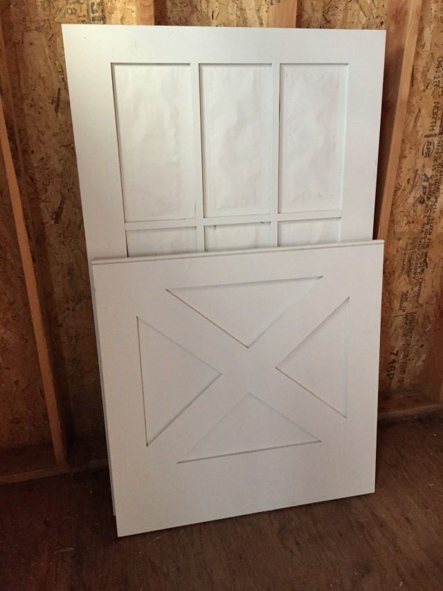 Here's the dutch door for the mudroom front door. Isn't it cute with the X detail in the bottom half? It's the only door we ordered like that...I thought it would be fun for the front of the house.