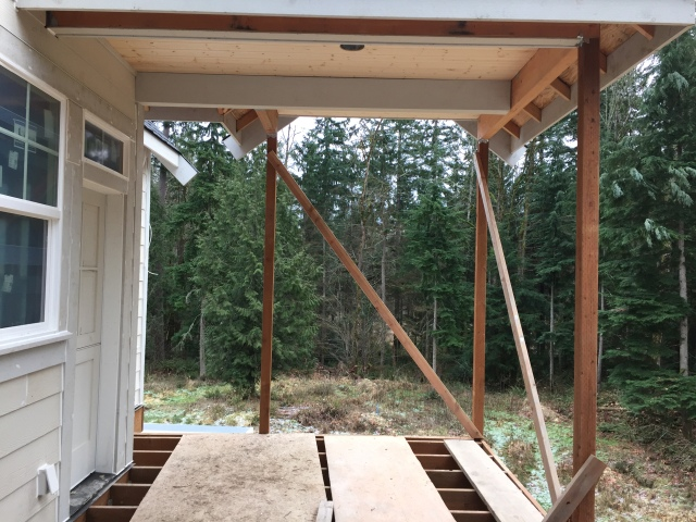 Here's a view from the mudroom back door to the back yard - the covered porch here is where the BBQ will end up going.