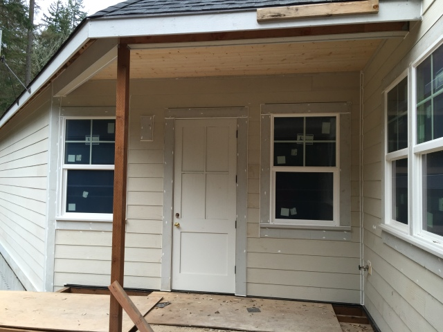 This is the backdoor to the mudroom with the windows to the mudroom and the mudroom bathroom.