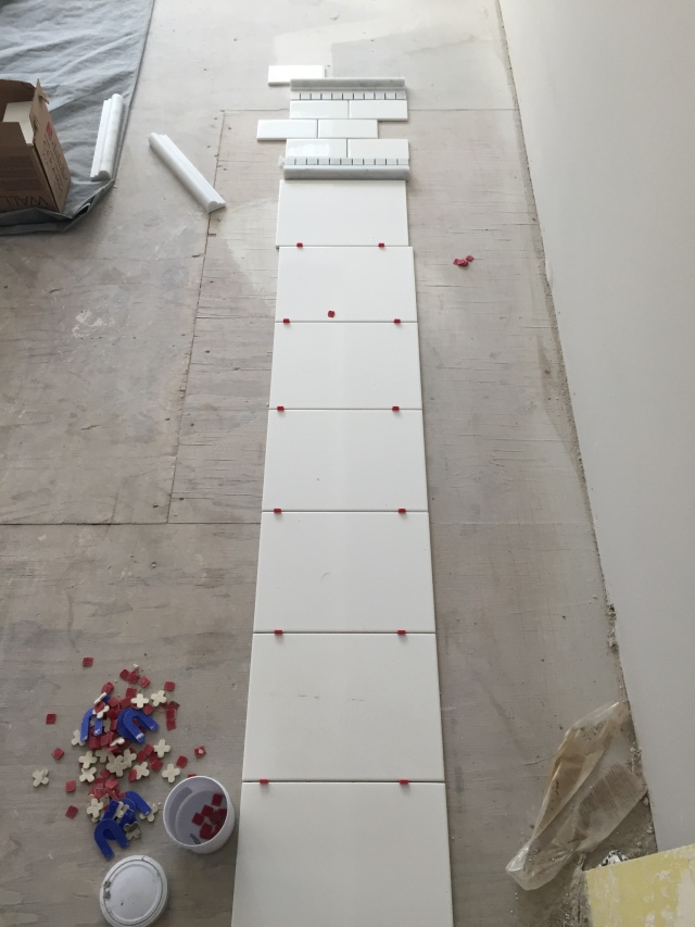 This is the layout of the tile in the master shower. The lower & larger white tiles will be in a brick pattern, then there will be a detail band and then white subway tiles above it.